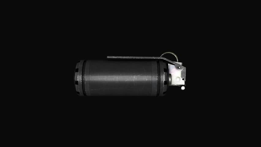 Grenade on a gray background levitation of standard timed fuze hand grenade. Tear-gas hand grenade rotation on grey background.