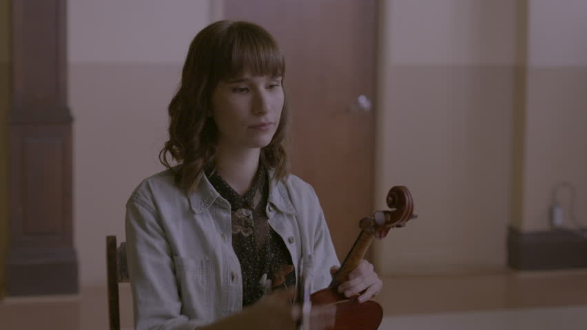 Musician getting ready to play violin HD stock video. Alexa camera