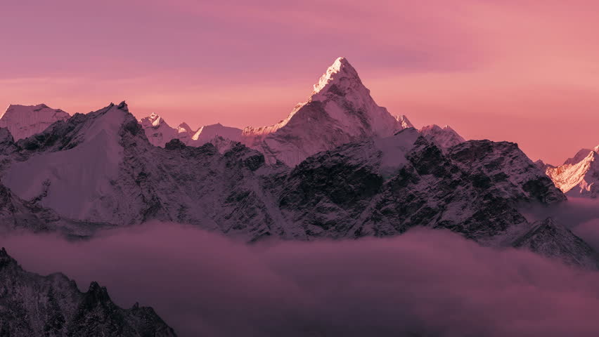 Greatness of nature: grandiose view of Ama Dablam peak (6812 m) at sunrise. Nepal, Himalayan mountains. Time lapse zoom.   Shutterstock HD Video #1010566118