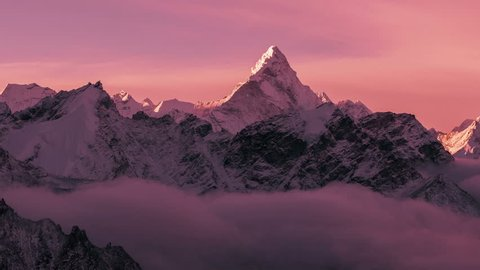 Greatness of nature: grandiose view of Ama Dablam peak (6812 m) at sunrise. Nepal, Himalayan mountains. Time lapse zoom.