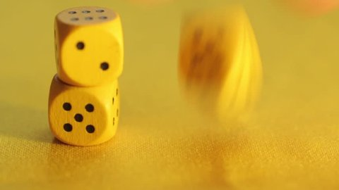Yellow wooden chips dice. Three Dice roll