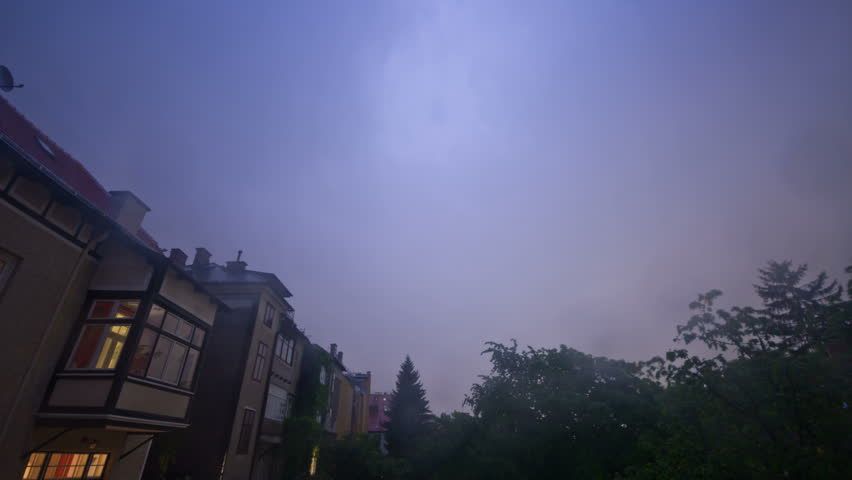 Thunderstorm time-lapse at night over the outskirts of Vienna, Austria. Several lightning strikes enlighten the sky.