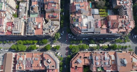 Aerial top view of Barcelona Eixample district street and buildings, urban area, Spain