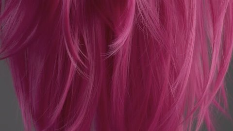 Closeup of pink hair creative colored texture tilt up camera movement