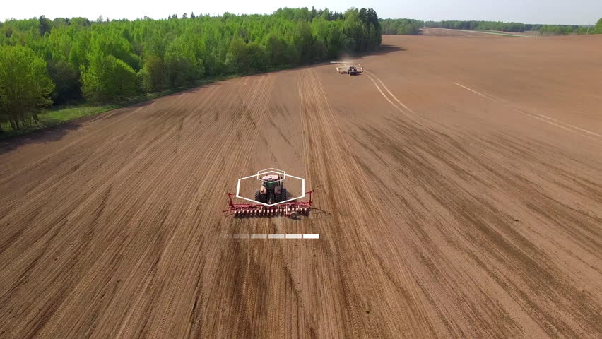 Two tractors going in the opposite direction and cultivating land with using an advanced autopilot and radar system, sensor and control of the surrounding space detectors. 4k
