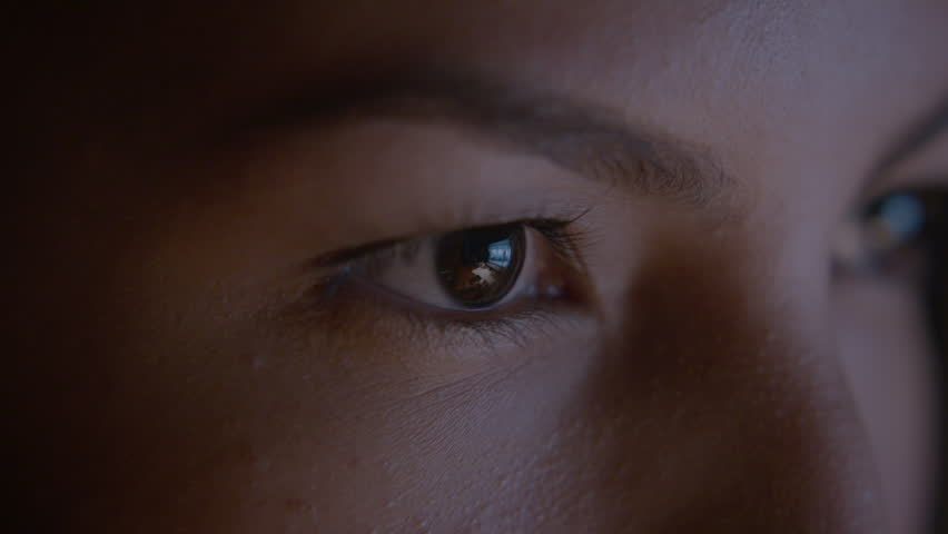Close up of female's eyes surfing the internet on her computer. HD stock video. Alexa camera