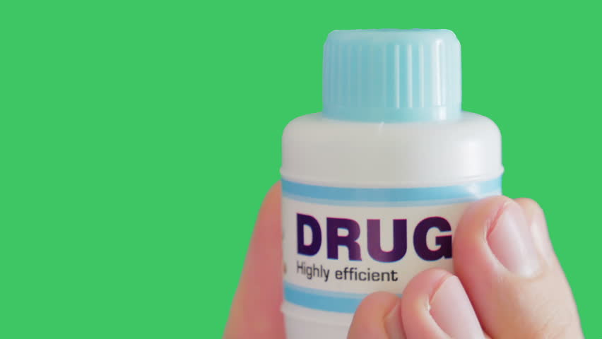 Doctor holds bottle with highly efficient drug. Lethally Dangerous Diseases. Keying ready. Green screen.