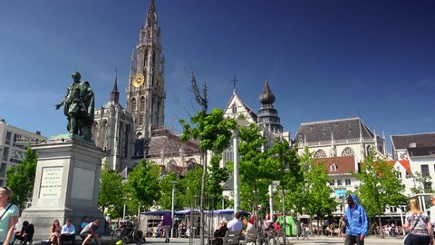 Antwerp, Belgium - circa 2018: Cathedral of Our Lady and statue of Peter Paul Rubens. The cathedral is the highest church in the Benelux with 123 m (404 ft) of height.