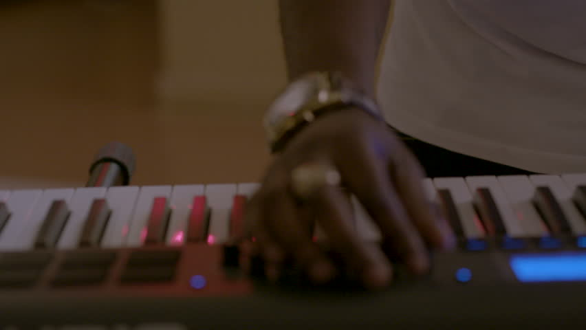 Close-up of DJ mixing with keyboard HD stock video. Alexa camera