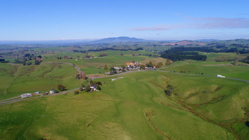 Aerial view of north island of New Zealand, picturesque lush green hills of Shire/Hobbiton (The Lord of the Rings and Hobbit location), sunset time, 4k UHD