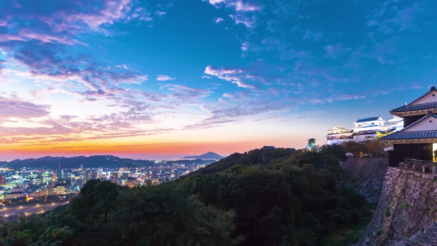 Sunset time-lapse of Matsuyama Castle, in Japan | Shutterstock HD Video #1010843798