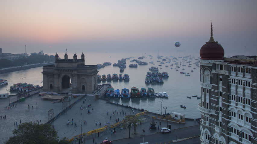 Jan 2018, India, Mumbai, Maharashtra, The Gateway of India, monument commemorating the landing of King George V and Queen Mary in 1911 - night to day time lapse