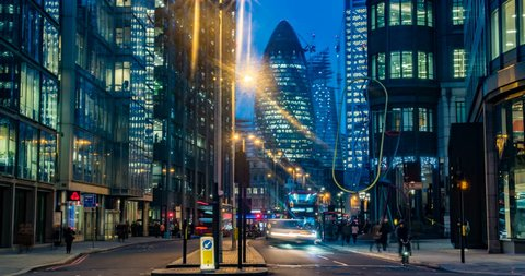 Timelapse view of a busy crossroad at a traffic light in the hearth of the financial district of the City of London