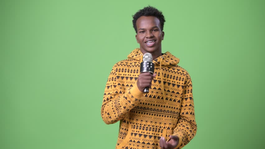 Young African man against green background | Shutterstock HD Video #1010874788