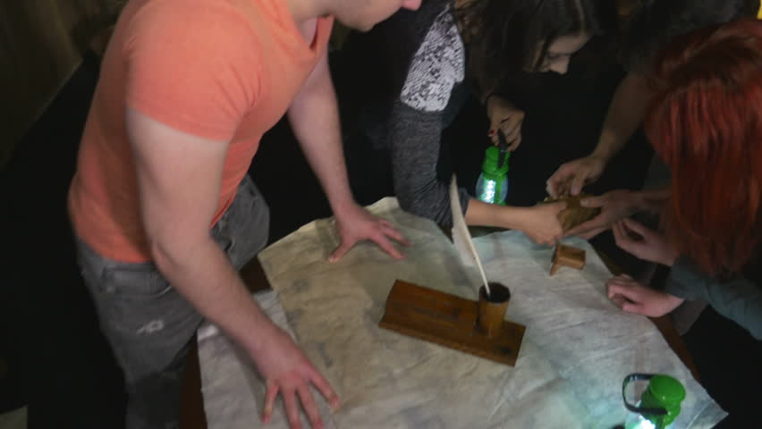Colleagues opening mysterious wooden box in a team building escape room game