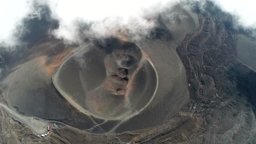 Aerial of Mount Etna volcanic crater one of the flank craters is roughly circular depression in ground caused by volcanic activity and is typically bowl-shaped feature also showing people walking 4k