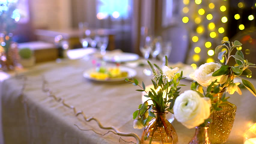 decorated table for a wedding dinner. Elegant banquet tables prepared for a conference or a party, banquet table set for an event. Served banquet table in the restaurant. Banquet dinner. slow-motion