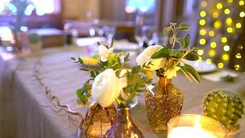 Served banquet table in restaurant. decorated table for a wedding dinner. Elegant banquet tables prepared for a conference or a party, banquet table set for an event. Banquet dinner. slow-motion