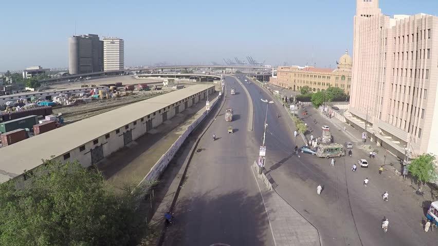 Track in Aerial shot of a street near port and EFU Building, Karachi, Pakistan. May 3rd 2016