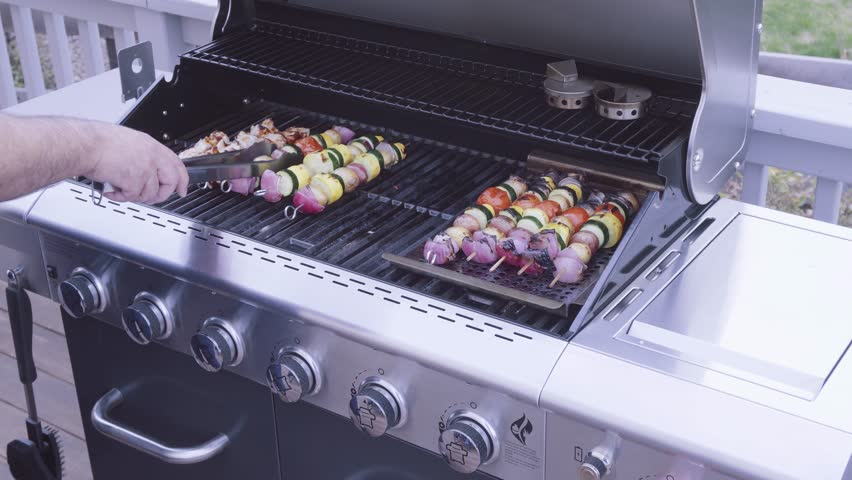 Step by step. Grilling veggie skewers and chicken kebabs on outdoor gas grill. | Shutterstock HD Video #1010902448