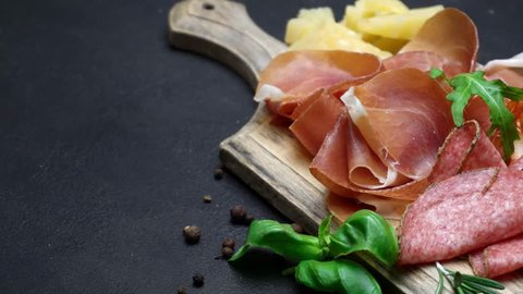 Video of italian meat plate - sliced prosciutto, sausage and cheese