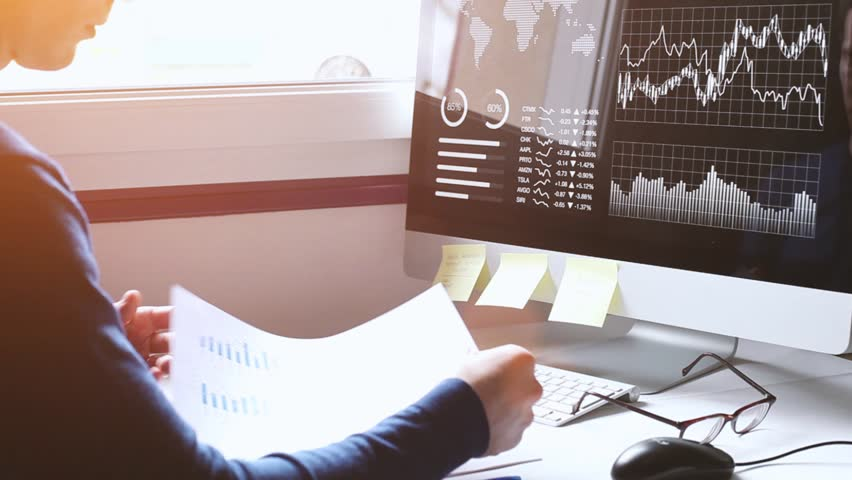Financial report analytics, business man studying charts, graphs and diagrams on dashboard on computer screen, fintech concept, KPI, businessman working in office | Shutterstock HD Video #1010940758