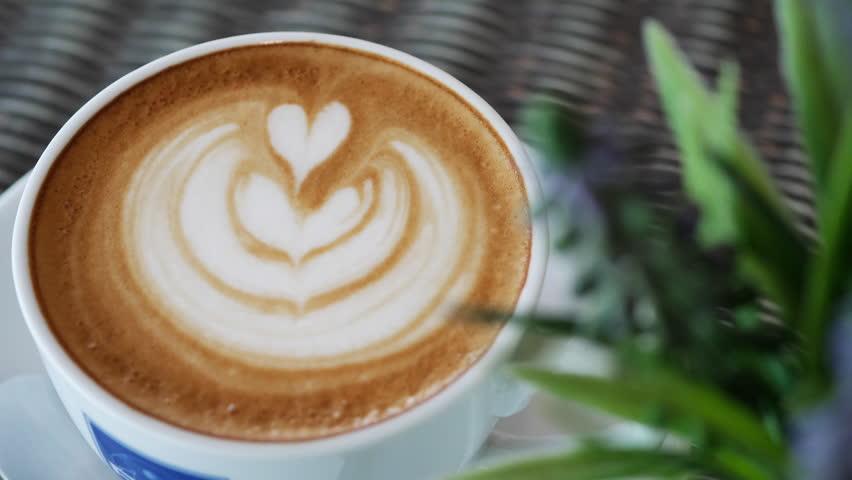 latte art heart shape of hot coffee drink in cup
