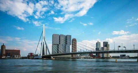 Timelapse of Rotterdam cityscape and Erasmus bridge over Nieuwe Maas. Rotterdam , Netherlands. Camera zoom in
