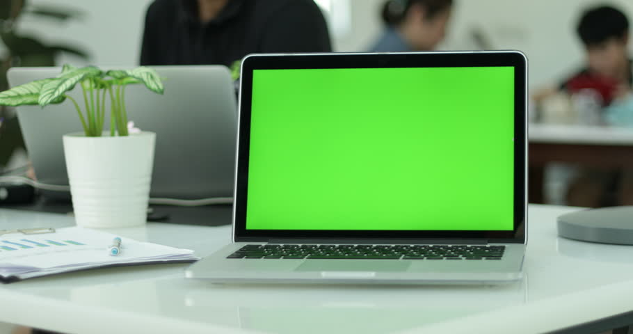 Green laptop computer screen set in front of workgroup #1011012248