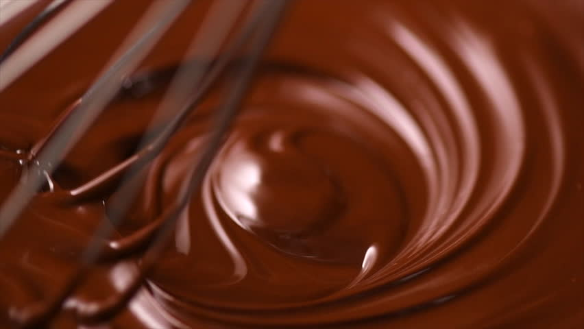 Chocolate. Mixing melted liquid premium dark chocolate with a whisk. Close up of liquid hot chocolate swirl. Confectionery. Confectioner prepares dessert, icing. 4K UHD video, slow motion 120 fps | Shutterstock HD Video #1011104918