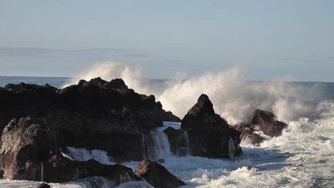 Rolling Crashing Waves Splashing Against Lava Rock On Atlantic Coast