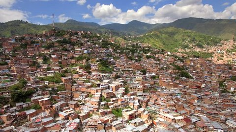 Medellin, Colombia, aerial view of Comuna 13 slums. Once one of the most dangerous neighbourhoods in Colombia, the Comuna 13 reinvented itself in recent times and is now considered safe to visit.