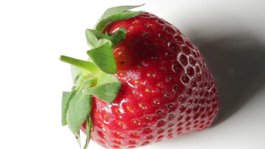 A ripe strawberry, in rotation on a white background | Shutterstock HD Video #1011280028