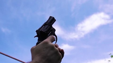 Man shoots with a pistol to the sky to signal the start. Slow-motion shooting of 960 frames per second.