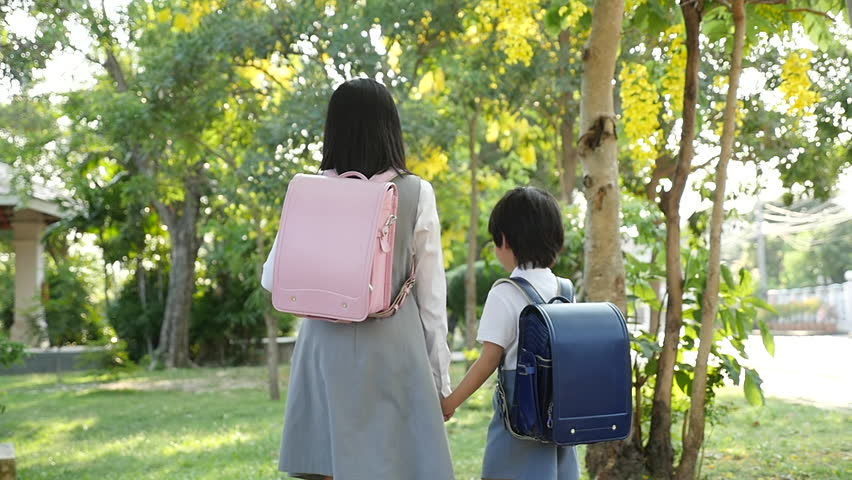 Cute Asian children going to the school outdoors    Shutterstock HD Video #1011315008