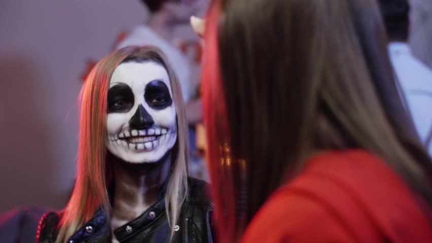 Portrait of woman in costume at halloween party | Shutterstock HD Video #1011325568
