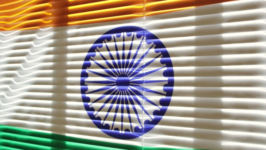 Indian flag is moving from the blowing draft at jalousie window in sunny day. | Shutterstock HD Video #1011412238