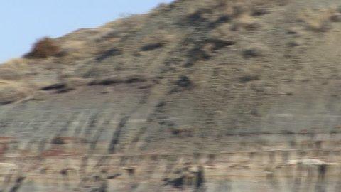 Badlands in Spring Sediment Strata Color Layers Geology in North Dakota