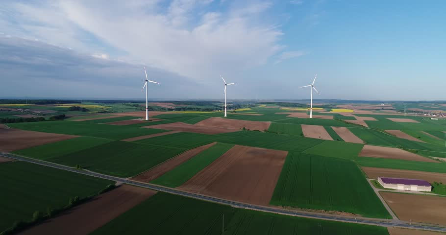 Air panoramas of agricultural fields and wind generators producing electricity. Modern technologies for obtaining alternative wind energy. Aerial view. | Shutterstock HD Video #1011493358