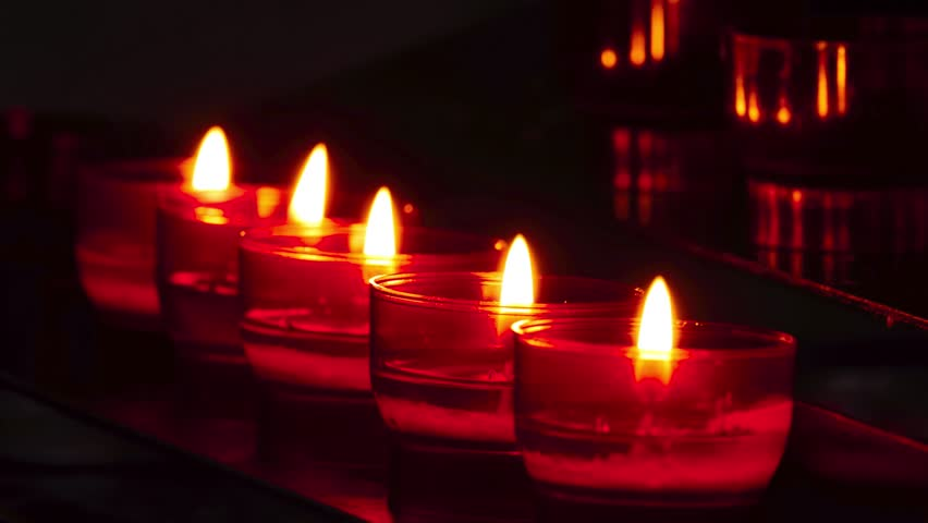 Small red candles for ritual purposes in Catholic church near iconostasis. | Shutterstock HD Video #1011494198