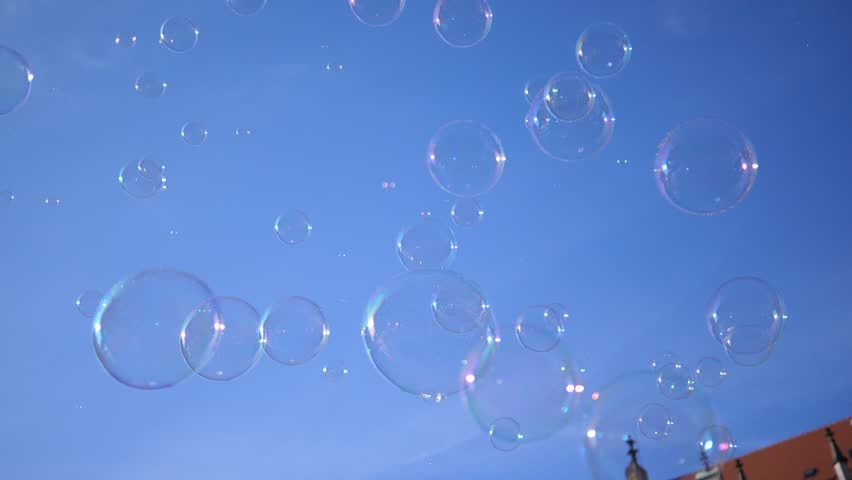 Slow motion fly of a big soap bubble in a city center public place in Wroclaw Poland   Shutterstock HD Video #1011507938