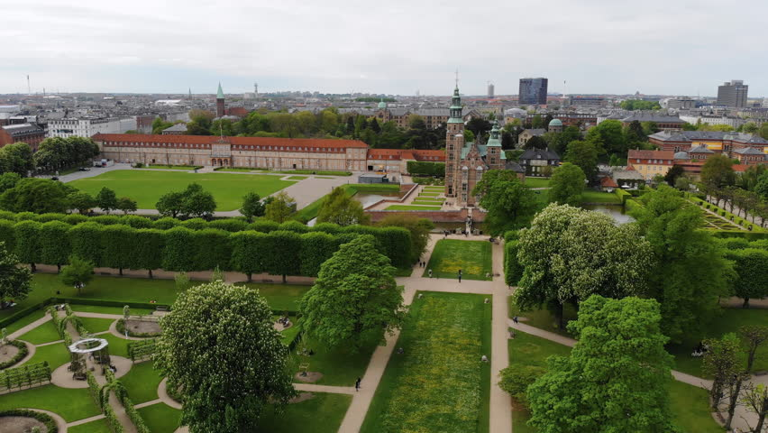 Aerial view of Rosenborg Castle (renaissance style palace) situated in The King's Garden (Kongens Have) - central Copenhagen, capital city of Denmark from above | Shutterstock HD Video #1011516218