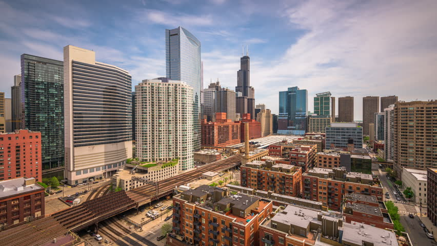Chicago, Illinois, USA cityscape time lapse over elevated train lines.