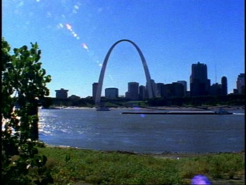 ST. LOUIS, 1999, St. Louis Arch, with skyline, Mississippi River, barges moving, wide shot