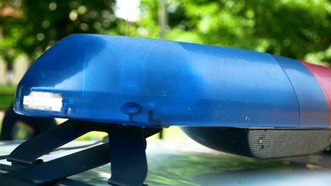 A police patrol car. Flashing beacons
