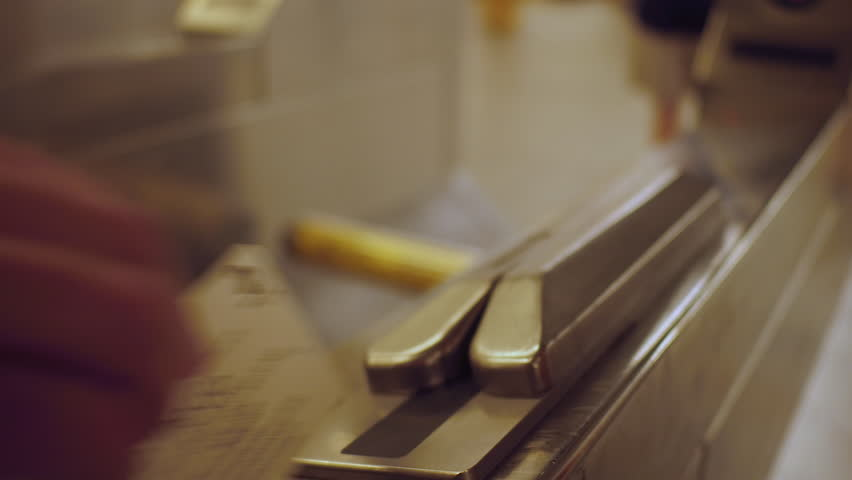 Swiping ticket thru subway turnstile. | Shutterstock HD Video #1011564428