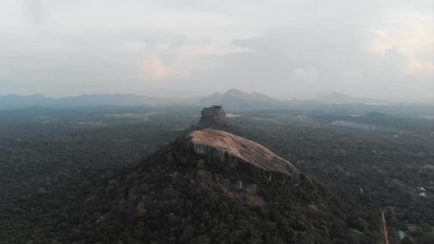 Cinematic aerial over pidurangala and sigiriya rock at sunset, two of the most famous places of Sri Lanka. Shot in 4k.