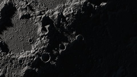 The surface of the Earth's Moon: close-up to a detail full of shadows, then the camera zooms out to show a wider view of the terrain. Elements of this image furnished by NASA