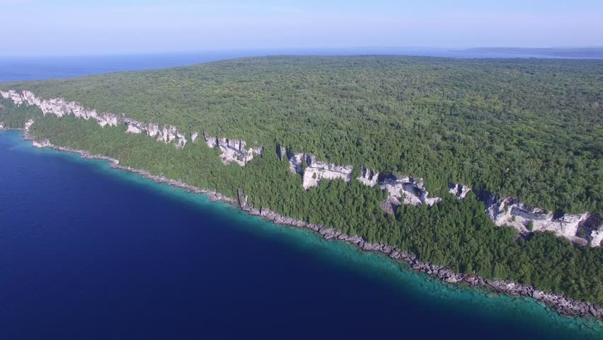 Drone slowly descending towards Bruce Peninsula cliffs at Lion's Head