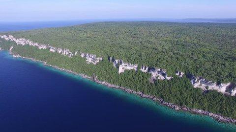 Drone slowly descending towards Bruce Peninsula cliffs at Lion's Head